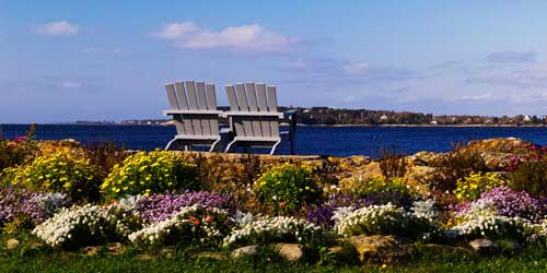 Exterior Garden with Chairs Ocean Point Inn East Boothbay Maine