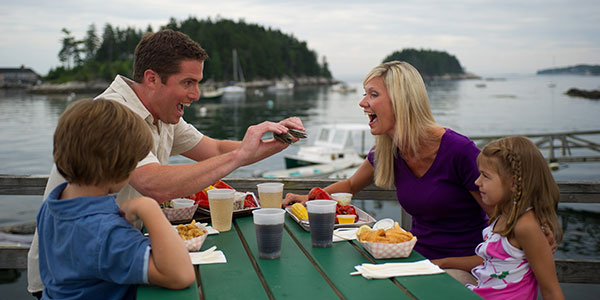 Summer in Maine - Family Eating Clams OUtdoors - Photo Credit Maine Office of Tourism